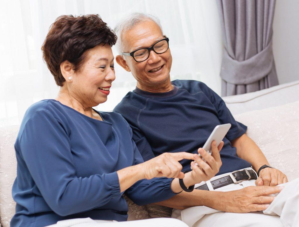 Image of Senior Couple using phone.