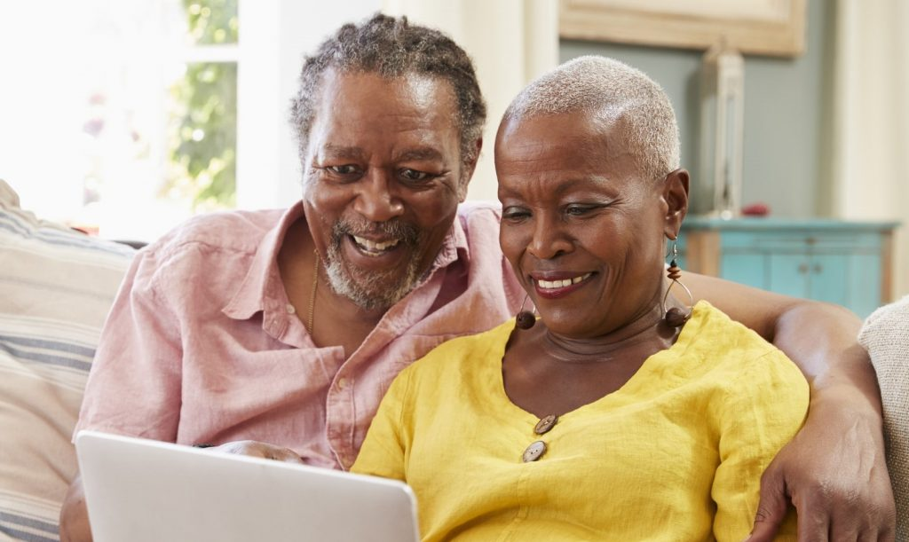 senior couple looking at computer