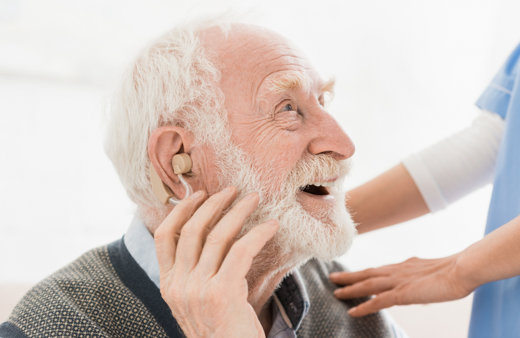 Image of senior hearing patient with nurse.