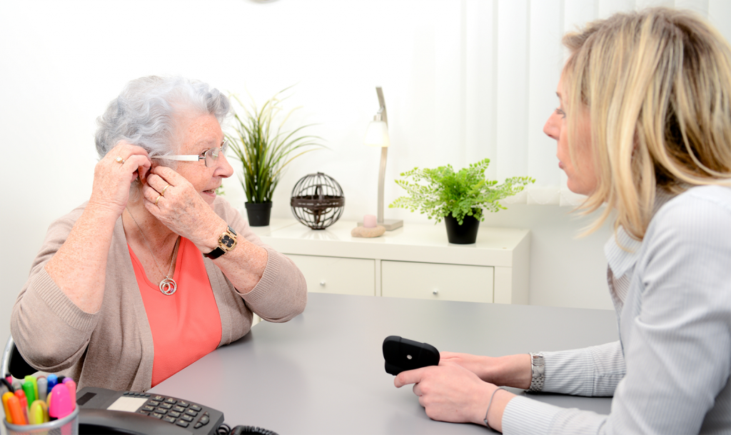 Image of senior hearing patient during consultation.