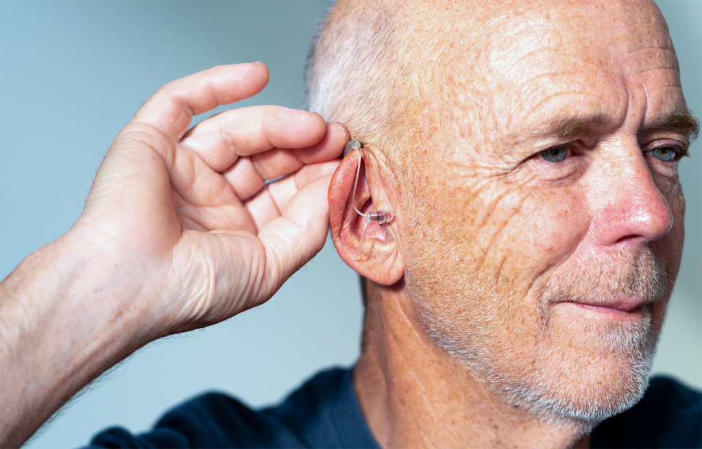 image of hearing aid patient testing hearing device