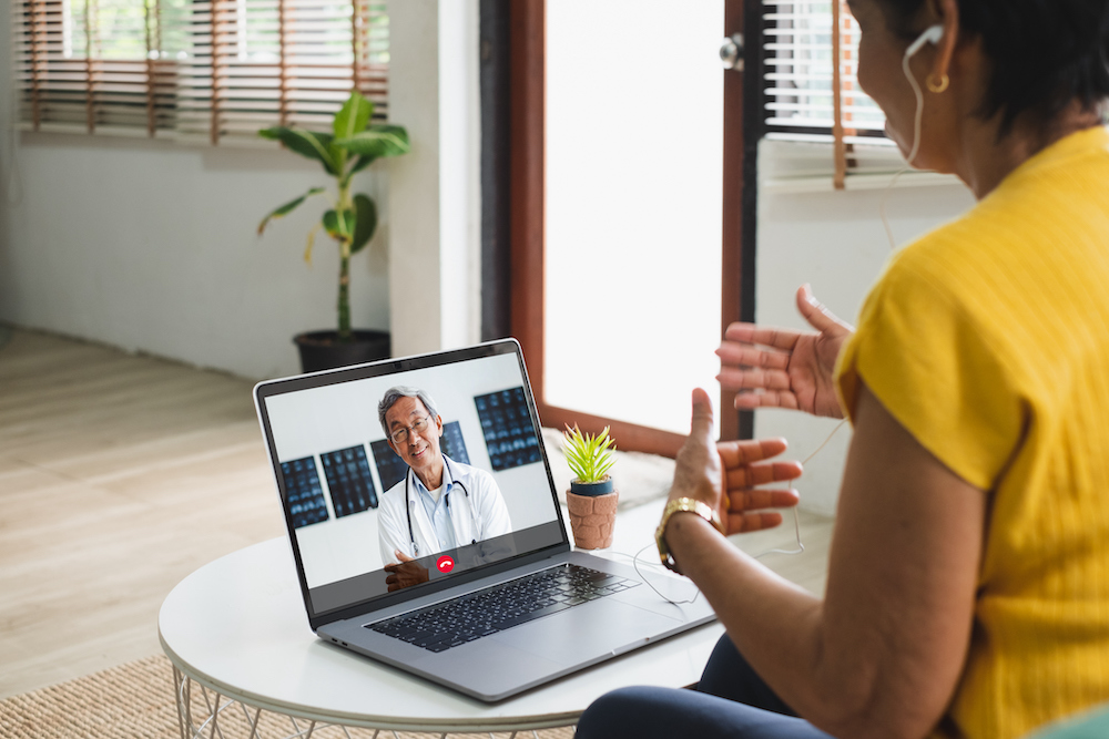 Asian senior video call with doctor telemedicine appointment